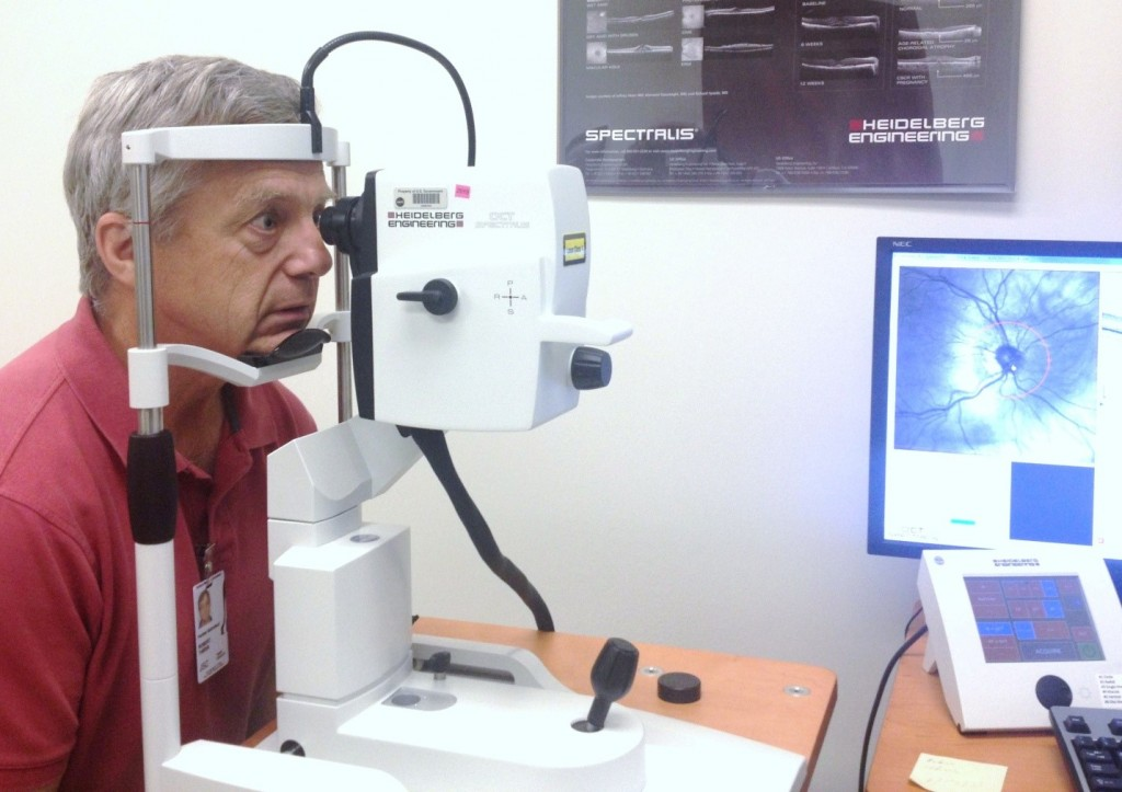 Performing an Optical Coherence Tomography (OCT) imaging test to look in-depth for any changes in my retinas