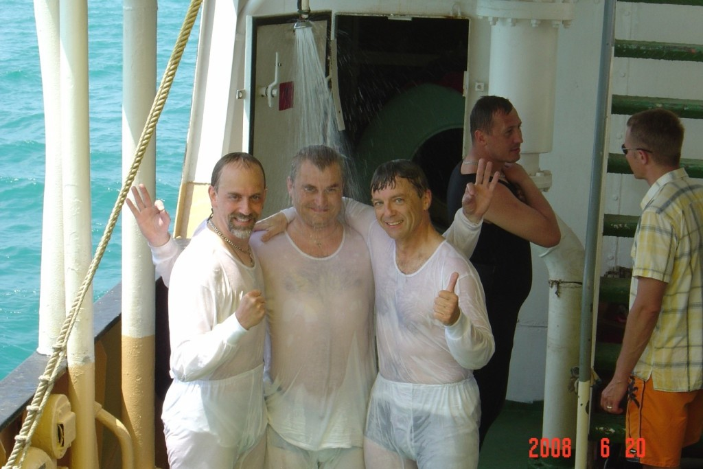 Richard, Alexey and me cooling off under a shower after a successful second training run.